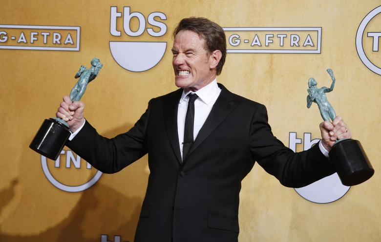 Bryan Cranston winner of the Outstanding Performance by a Male Actor in a Drama Series award for his role in ''Breaking Bad'' poses for photo backstage at the 20th annual Screen Actors Guild Awards in Los Angeles, California January 18, 2014. REUTERS/Lucy Nicholson