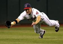 Cleveland Indians Grady Sizemore fails to make a diving catch on a hit by Alex Rodriguez during the ninth inning of the Indians MLB American League baseball game in Cleveland, Ohio July 6, 2011. REUTERS/Aaron Josefczyk
