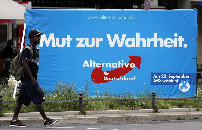 A pedestrian walks past an election campaign poster of the euro-critical Alternative for Germany party (Alternative fuer Deutschland) is pictured in Berlin August 27, 2013. REUTERS/Fabrizio Bensch