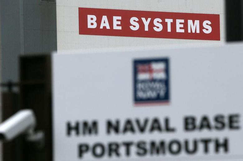 A BAE Systems sign is seen at the naval dockyards in Portsmouth, southern England November 6, 2013. REUTERS/Stefan Wermuth