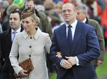 Britain's Zara Phillips (L) and her husband Mike Tindall walk to St. Mary's church to attend the annual Christmas service on the Royal Estate at Sandringham in Norfolk, eastern England December 25, 2012. REUTERS/Toby Melville