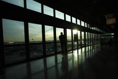 A passenger watches the Newark Liberty International Airport from the airtrain station in Newark, New Jersey November 15, 2012. REUTERS/Eduardo Munoz