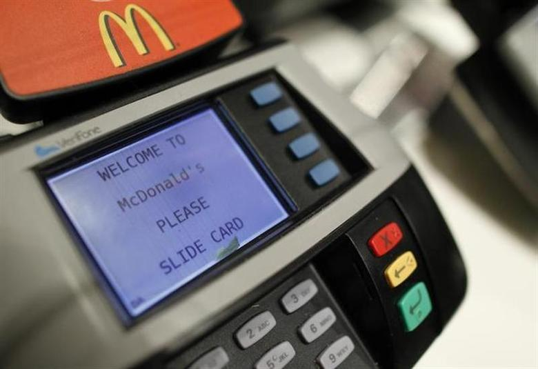A credit card scanner is seen at a McDonald's restaurant in New York April 19, 2011. REUTERS/Brendan McDermid