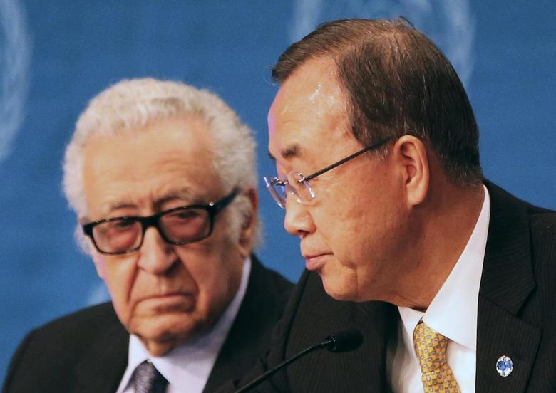 U.N. special envoy for Syria Lakhdar Brahimi speaks to U.N. Secretary-General Ban Ki-moon (R) during a news conference after the Geneva-2 peace talks in Montreux January 22, 2014. REUTERS/Jamal Saidi
