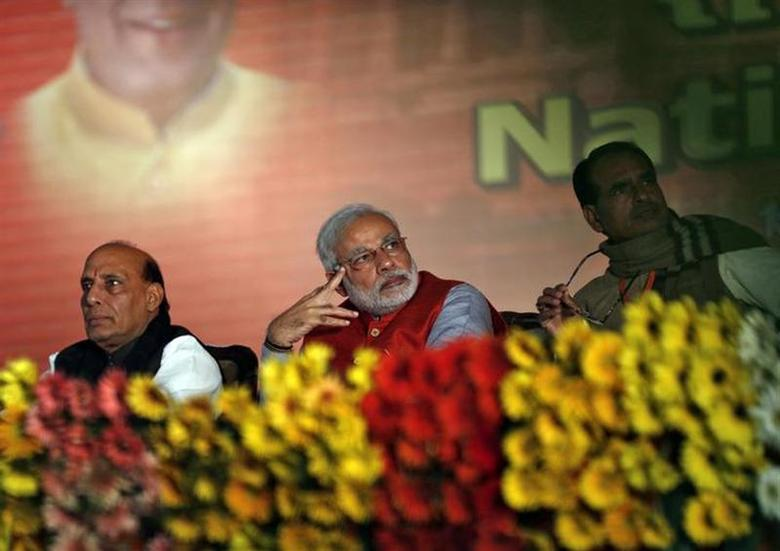 (From L to R) Rajnath Singh, president of Bharatiya Janata Party (BJP), Hindu nationalist Narendra Modi, prime ministerial candidate for BJP and Gujarat's chief minister, and Shivraj Singh Chouhan, chief minister of Madhya Pradesh, attend their party's national council meeting at Ramlila ground in New Delhi January 18, 2014. REUTERS/Ahmad Masood