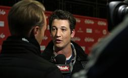 """Cast member Miles Teller answers a reporter's question during the premiere of """"Whiplash"""" at the Sundance Film Festival in Park City, Utah January 16, 2014. REUTERS/Jim Urquhart"""
