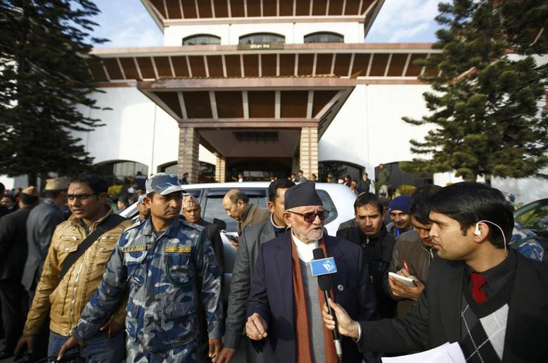 Chairman of the Nepali Congress Party Sushil Koirala (C) speaks to a member of the media as he walks out from the parliament in Kathmandu January 22, 2014, after attending the first parliament meeting held after the November 19, 2013 Constituent Assembly elections. The new assembly was elected to write a constitution after the abolition of the 240-year-old feudal monarchy that the Maoists fought against. REUTERS/Navesh Chitrakar