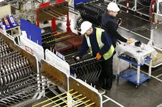 Workers inspect components on the fuel inlet production facility at Futaba Industrial in Foston, central England in this January 21, 2014 file photo. REUTERS/Darren Staples/Files