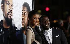 """Cast member Kevin Hart and Eniko Parrish pose at the premiere of """"Ride Along"""" at the TCL Chinese theatre in Hollywood, California January 13, 2014. REUTERS/Mario Anzuoni"""