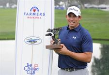 Jan 26, 2014; La Jolla, CA, USA; Scott Stallings poses with the Farmers Insurance Open championship trophy after the third round of the Farmers Insurance Open golf tournament at Torrey Pines Municipal Golf Course - South Co. Mandatory Credit: Christopher Hanewinckel-USA TODAY Sports