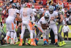 January 26, 2014; Honolulu, HI, USA; Team Rice fullback Mike Tolbert of the Carolina Panthers (35) scores the game-winning two-point conversion during the fourth quarter of the 2014 Pro Bowl against Team Sanders at Aloha Stadium. Kyle Terada-USA TODAY Sports