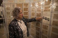 Jewish Holocaust survivor Irena Wodzislawski points to pictures displayed at a museum commemorating the six million victims of the Nazi genocide, inside her home in the West Bank Jewish settlement of Ariel January 23, 2014. REUTERS/Ronen Zvulun