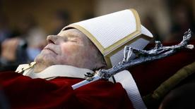 Pall bearers carry the body of the late Pope John Paul II through a packed Saint Peter's Square at the Vatican. REUTERS/Kai Pfaffenbach