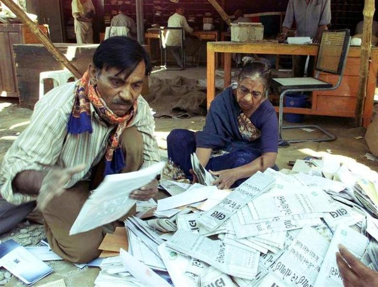 Indian postal employees sort mail in an open area at the main post office of Bhuj in the western state of Gujarat on February 6, 2001. REUTERS/Files