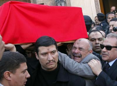Gunmen kill Egyptian general; ousted Mursi defiant at trial