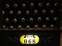 Bottles of wines, which are kept in a VIP customers' cabinet, are seen at the BOCUI wine club's wine cellar during a photo opportunity in Beijing August 5, 2013. REUTERS/Kim Kyung-Hoon