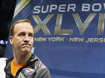 Denver Broncos quarterback Peyton Manning pauses during Media Day for Super Bowl XLVIII at the Prudential Center in Newark, New Jersey January 28, 2014. REUTERS/Shannon Stapleton