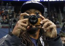 Seattle Seahawks cornerback Richard Sherman takes some pictures as he arrives for Media Day for Super Bowl XLVIII at the Prudential Center in Newark, New Jersey January 28, 2014. REUTERS/Shannon Stapleton