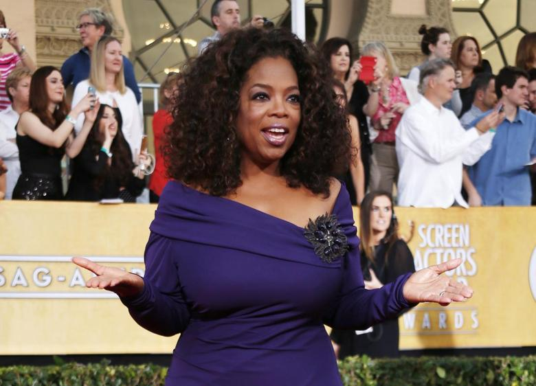 Actress Oprah Winfrey from the film ''The Butler'' arrives at the 20th annual Screen Actors Guild Awards in Los Angeles, California January 18, 2014. REUTERS/Lucy Nicholson