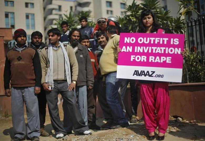 A demonstrator holds a placard during a protest outside a court in New Delhi January 21, 2013. REUTERS/Adnan Abidi/Files