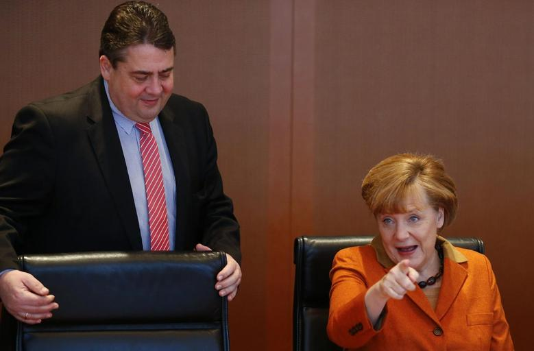 German Chancellor Angela Merkel and Economy Minister Sigmar Gabriel arrive for the weekly cabinet meeting in Berlin January 29, 2014. REUTERS/Tobias Schwarz