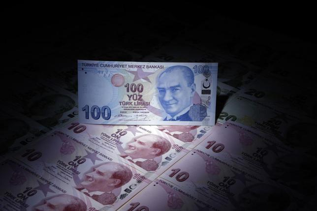 A Turkish 100 lira banknote is seen on top of 10 lira banknotes in this illustration picture taken in Istanbul January 28, 2014. REUTERS/Murad Sezer