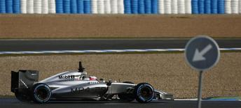 McLaren Formula One driver Jenson Button of Britain drives the new MP4-29 during pre-season testing at the Jerez racetrack in southern Spain January 29, 2014. REUTERS/Marcelo del Pozo