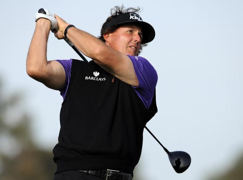 Jan 23, 2014; La Jolla, CA, USA; Phil Mickelson hits his tee shot from the ninth hole during the first round of the Farmers Insurance Open golf tournament at Torrey Pines Municipal Golf Course. Christopher Hanewinckel-USA TODAY Sports