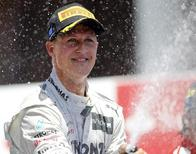 Mercedes Formula One driver Michael Schumacher of Germany sprays champagne during the podium ceremony after the European F1 Grand Prix at the Valencia street circuit June 24, 2012. REUTERS/Miguel Vidal