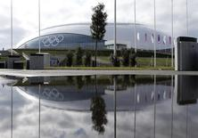 The Bolshoy Ice Dome is reflected in a puddle of water on the Olympic Park as preparations continue for the Sochi 2014 Winter Olympics, January 30, 2014. REUTERS/Fabrizio Bensch