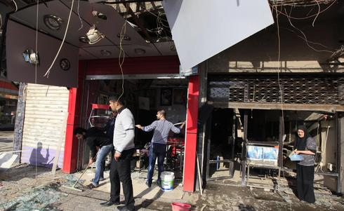 Suicide bombers storm Iraq ministry building, 24 killed