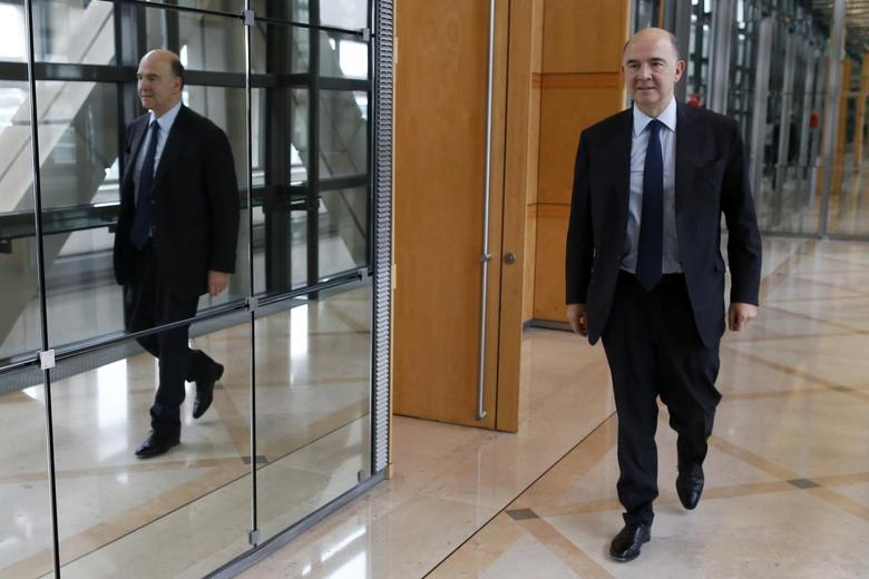 France's Finance Minister Pierre Moscovici leaves after an interview with Reuters at Bercy Finance Ministry in Paris, January 30, 2014. REUTERS/Charles Platiau