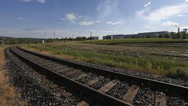 A railway track is seen near a factory in Lac-Megantic July 14, 2013. REUTERS/Mathieu Belanger