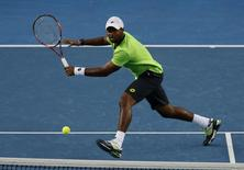 Donald Young of the United States plays a return to Kei Nishikori of Japan during their men's singles match at the Australian Open 2014 tennis tournament in Melbourne January 18, 2014. REUTERS/Bobby Yip