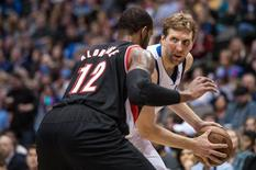 Jan 18, 2014; Dallas, TX, USA; Portland Trail Blazers power forward LaMarcus Aldridge (12) guards Dallas Mavericks power forward Dirk Nowitzki (41) during the first half at the American Airlines Center. Jerome Miron-USA TODAY Sports