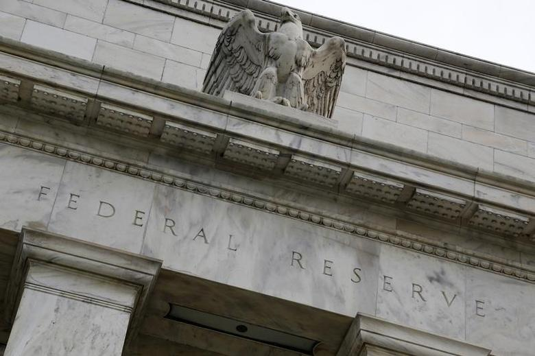 An eagle tops the U.S. Federal Reserve building's facade in Washington, July 31, 2013. REUTERS/Jonathan Ernst/Files