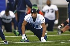 Seattle Seahawks wide receiver Golden Tate stretches at their NFL Super Bowl XLVIII football practice in East Rutherford, New Jersey, January 31, 2014. REUTERS/Shannon Stapleton