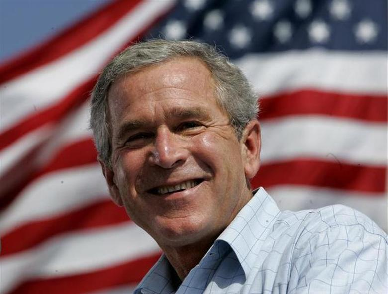 U.S. President George W. Bush smiles while speaking at a campaign rally in Lakeland, Florida, October 23, 2004. REUTERS/Kevin Lamarque/Files