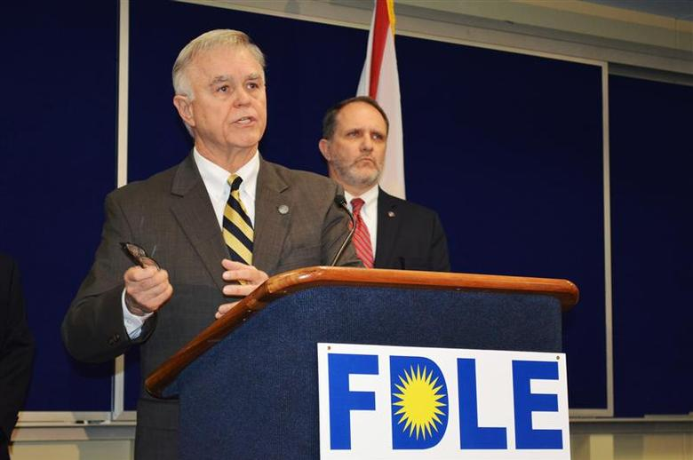Florida Department of Law Enforcement Commissioner Gerald Bailey, with Assistant FDLE Commissioner Jim Madden (R), announces an investigation into evidence tampering that could affect hundreds of drug cases handled by a chemist in the Pensacola FDLE laboratory during a news conference in Tallahassee, Florida, February 1, 2014. REUTERS/Bill Cotterell