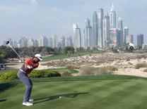 Tiger Woods of the U.S.takes a shot on the 8th tee during the third round of the 2014 Omega Dubai Desert Classic in Dubai February 1, 2014. REUTERS/Caren Firouz