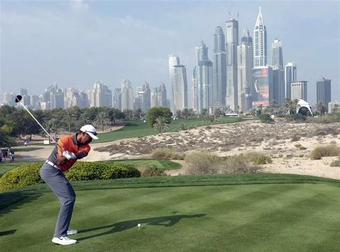 Woods vows to work on putter after muted Dubai showing