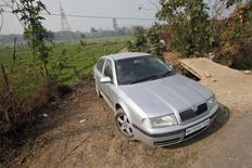 A villager drives a Skoda Octavia car through fields in Kishangarh village on the outskirts of the northern Indian city of Chandigarh January 31, 2014. REUTERS/Ajay Verma