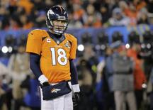 Denver Broncos quarterback Peyton Manning reacts after an incomplete pass during the third quarter against the Seattle Seahawks in the NFL Super Bowl XLVIII football game in East Rutherford, New Jersey, February 2, 2014. REUTERS/Ray Stubblebine