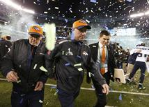 Denver Broncos head coach John Fox leaves the field after the Broncos werer defeated by the Seattle Seahawks in the NFL Super Bowl XLVIII football game in East Rutherford, New Jersey, February 2, 2014. REUTERS/Carlo Allegri