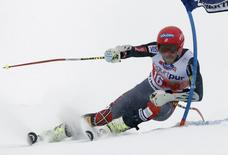 Bode Miller of the U.S. clears a gate during the first run of the men's World Cup giant slalom race in St. Moritz February 2, 2014. REUTERS/Christian Hartmann