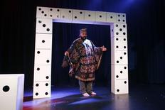 "French comedian Dieudonne M'Bala M'Bala, also known as just ""Dieudonne"", arrives at a news conference at the ""Theatre de la Main d'or"" in Paris January 11, 2014. REUTERS/Gonzalo Fuentes"