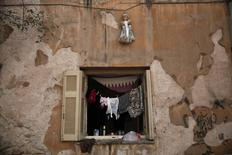 """A doll hangs over a window of an apartment at the """"Prosfygika"""" complex in Athens October 1, 2013. REUTERS/Yorgos Karahalis"""