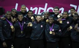 Members of the U.S. men's basketball team pose with their gold medals during victory ceremony at the North Greenwich Arena during the London 2012 Olympic Games August 12, 2012. REUTERS/Lucy Nicholson