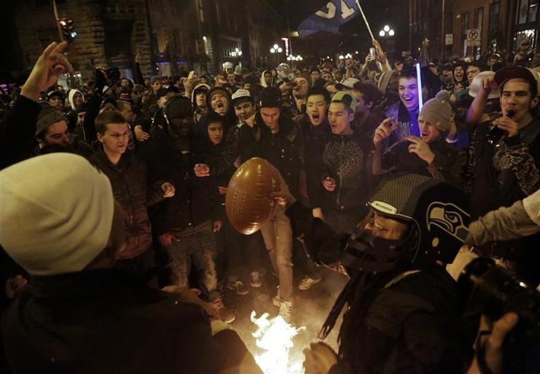 Seattle Seahawks fans celebrate by starting a small fire in the street after their team won the NFL Super Bowl XLVIII in Seattle, Washington February 2, 2014. REUTERS/Jason Redmond