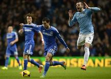 Manchester City's Alvaro Negredo (R) is challenged by Chelsea's Eden Hazard during their English Premier League soccer match at the Etihad Stadium in Manchester, northern England, February 3, 2014. REUTERS/Nigel Roddis